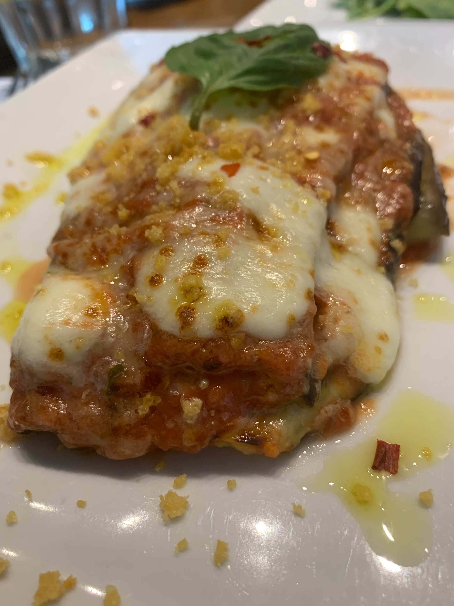 Eggplant parmigiana  Oven roasted eggplant, mozzarella cheese and tomato sauce with a touch of spice baked in our oven. *Gluten Free