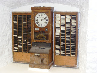 Time_clock_at_wookey_hole_cave_museum.JPG