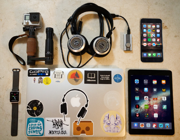 "Top to bottom; L to R: Shoulderpod with GoPro Hero 4, Grado SR325e, Schiit Audio Fulla, iPhone 7 Plus, Apple Watch Series 0, 15"" MacBook Pro Retina, and iPad Air 1."