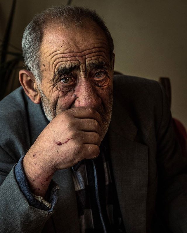 It's always a humbling experience shooting the portrait of an older person who has seen hard times and felt the hand of oppression. You can see all of the years of hard work and struggle in the wrinkles of their face and the scars on their hands. We gave this man some reading glasses and he read Scripture to us in Russian and Armenian.