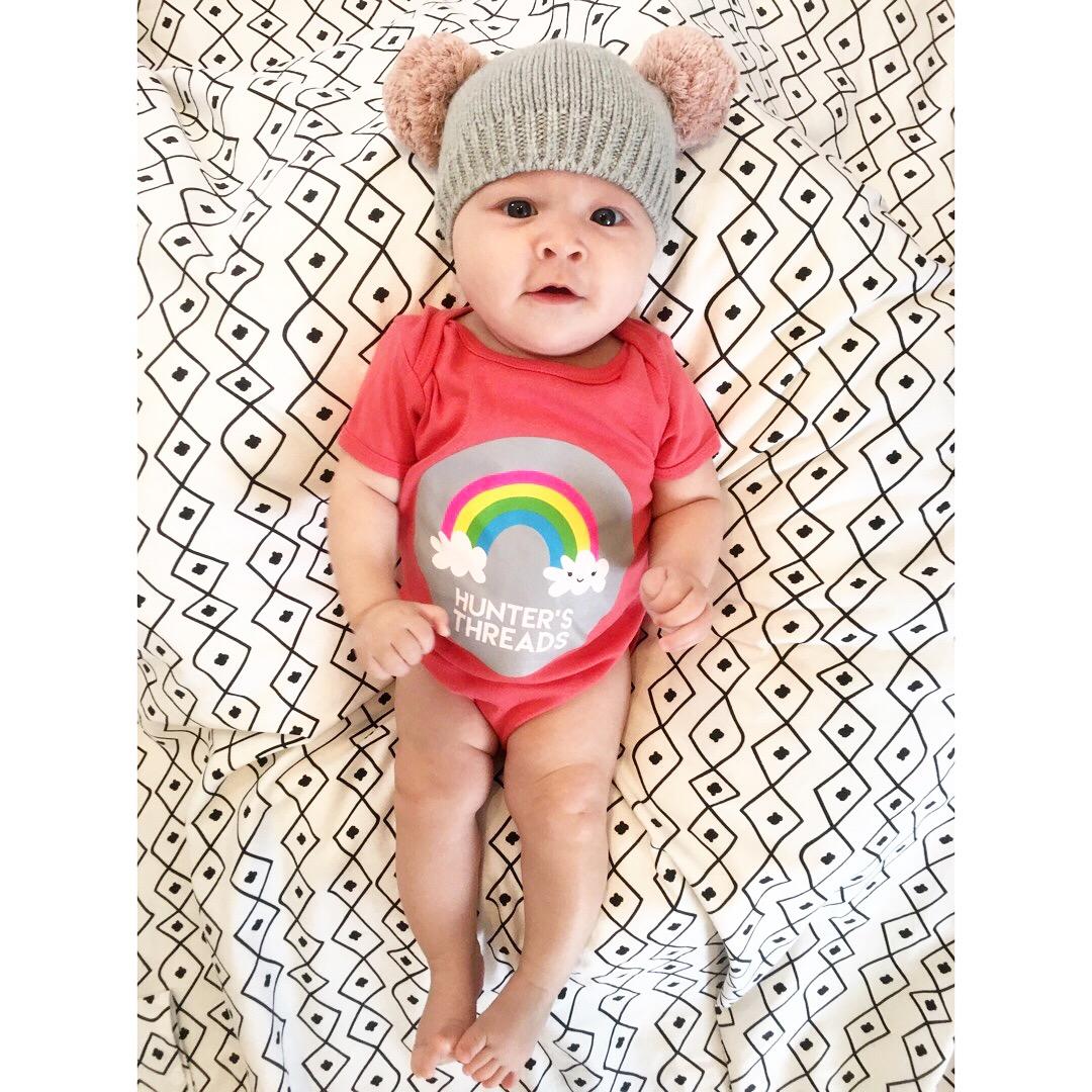 http://www.shophuntersthreads.com/kids-merchandise/kids-rainbow-logo-onesie-black