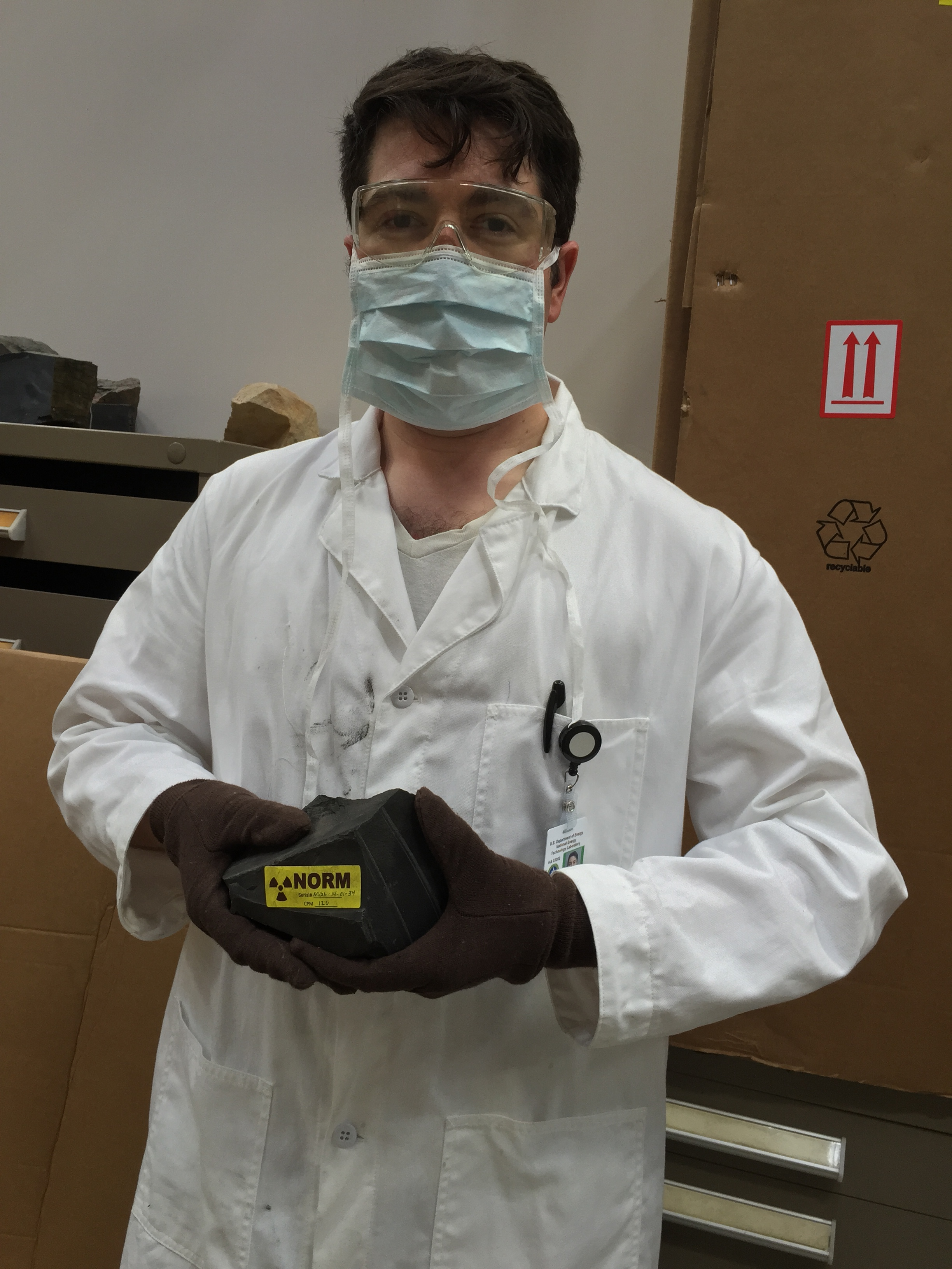 Handling NORM (Naturally Occurring Radioactive Material) at a research facility at NETL (National Energy Technology Laboratory). July 2015.