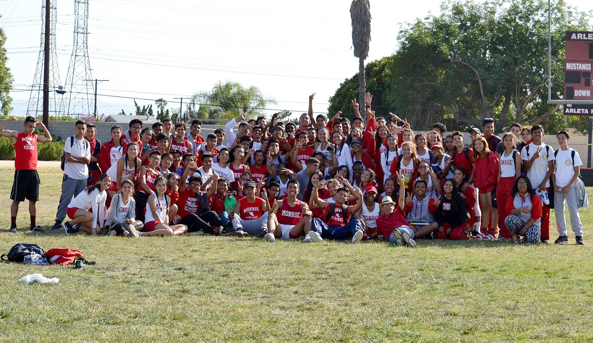 Coach Hernandez, Coach Harris, and his Spring 2016 track-and-field team.