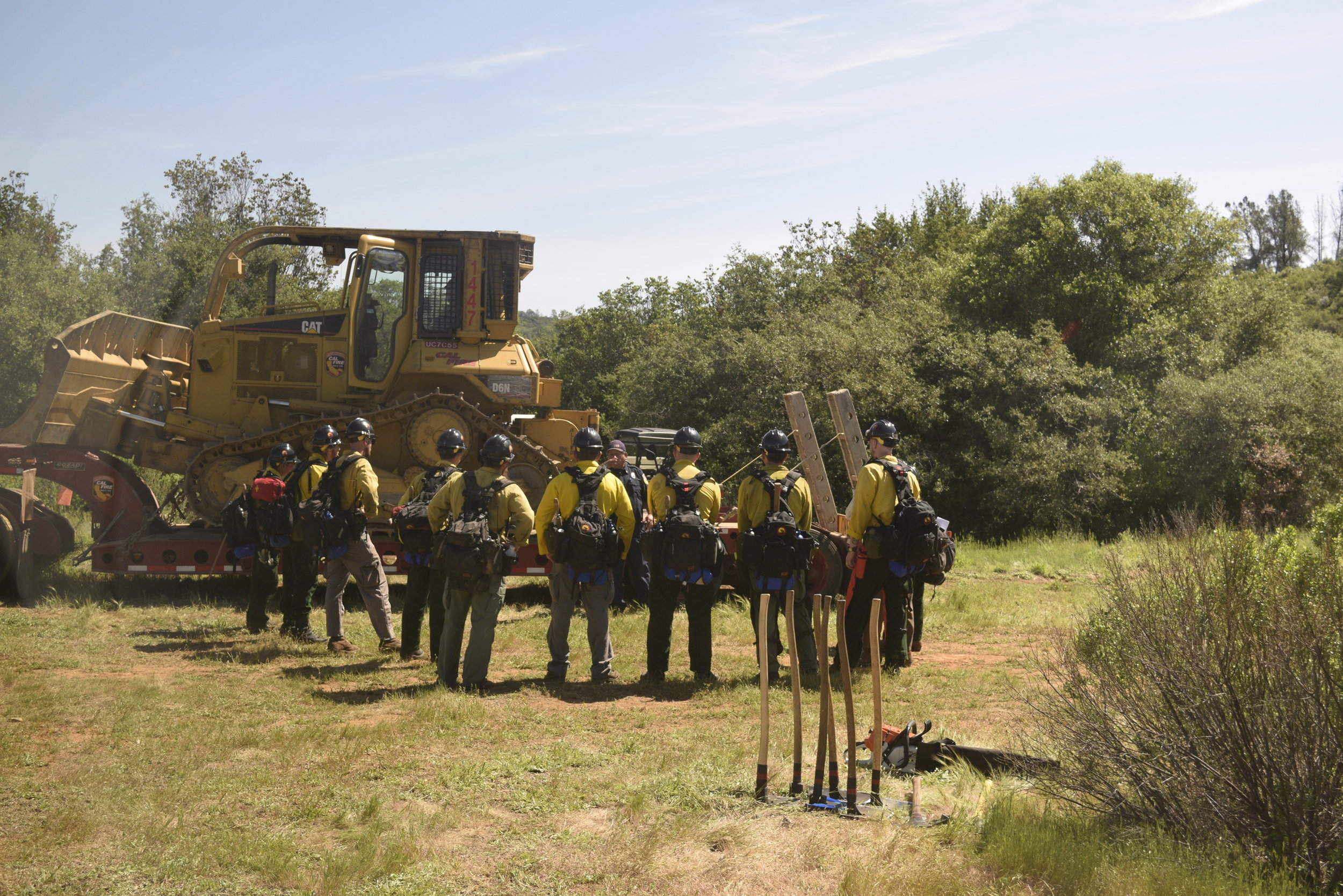 Dozer - operators gather for further instructions during training.