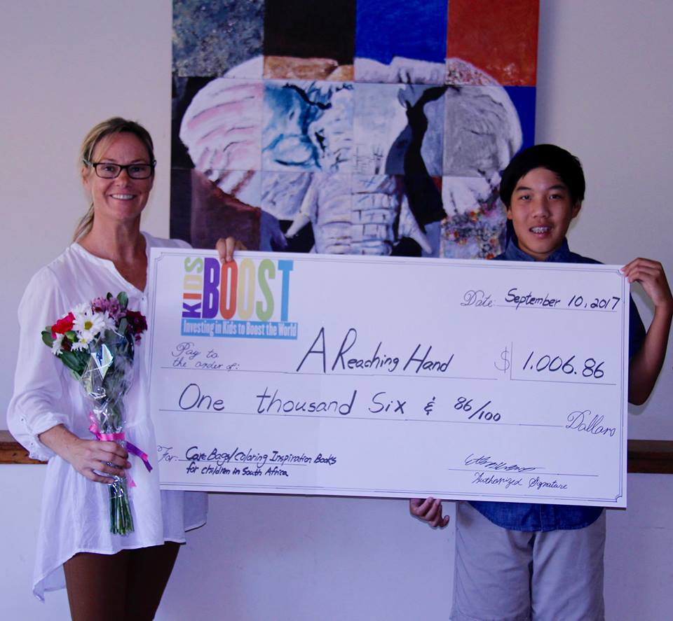 3 Helping Hands_Karin and Ethan with Cheque.jpg