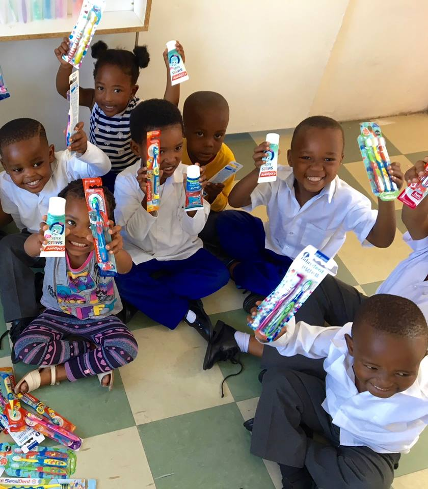 Phumezas Kids receiving Toobrushes and Toothpaste Donations from Sweden Group.jpg