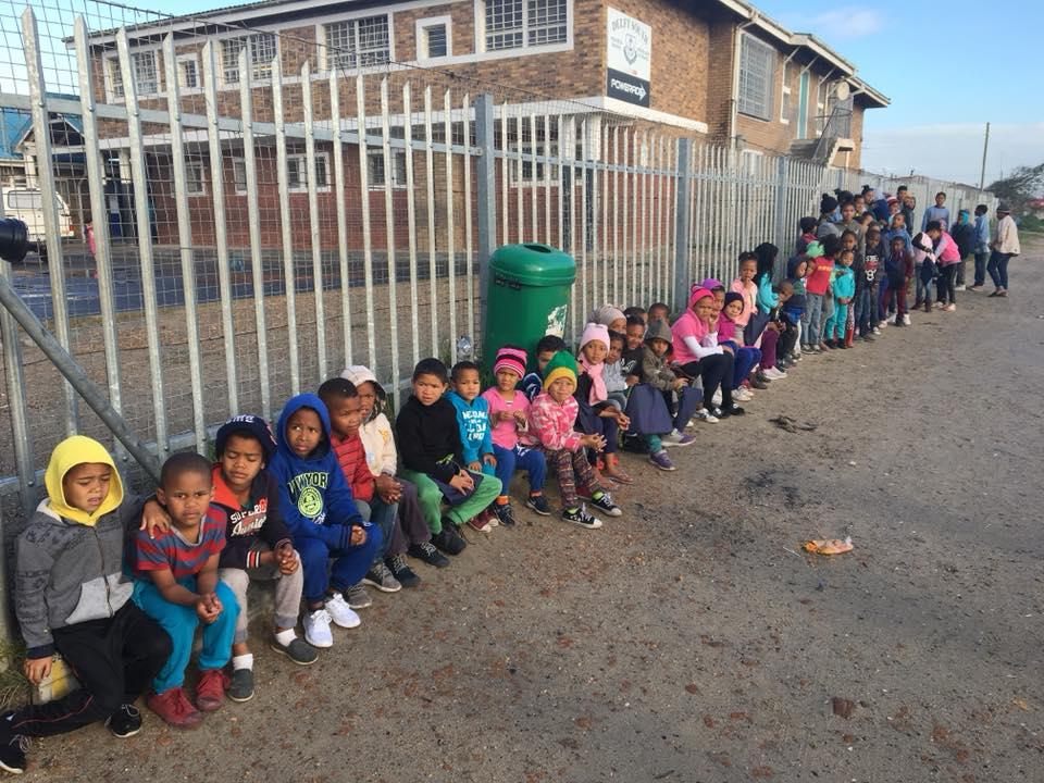 Children sitting in a row.jpg