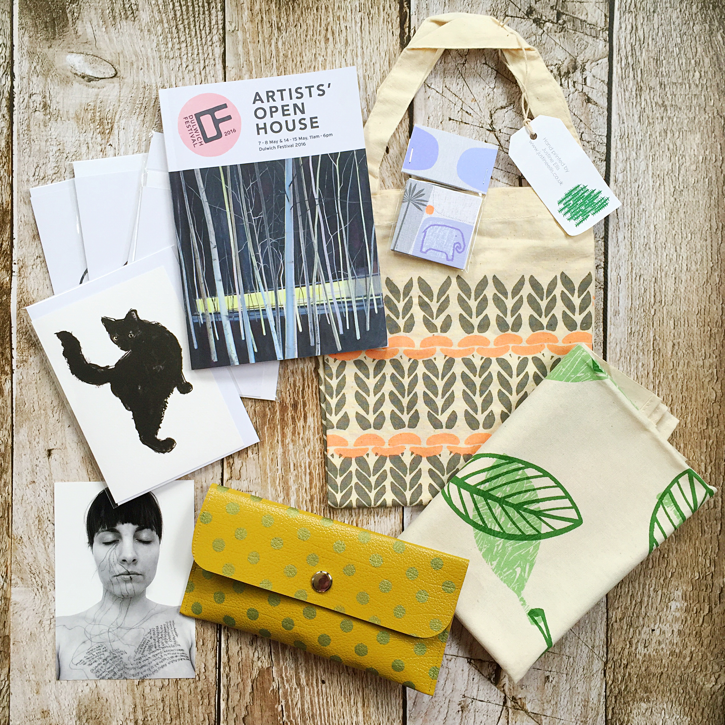 From top right: Tote bag and tea towel - Justine Ellis, mini cards (on the bag) - Sarah Hamilton, yellow spotty purse - Anna Jackson, postcard - Liz Atkin, cat greetings card - Tiff Howick