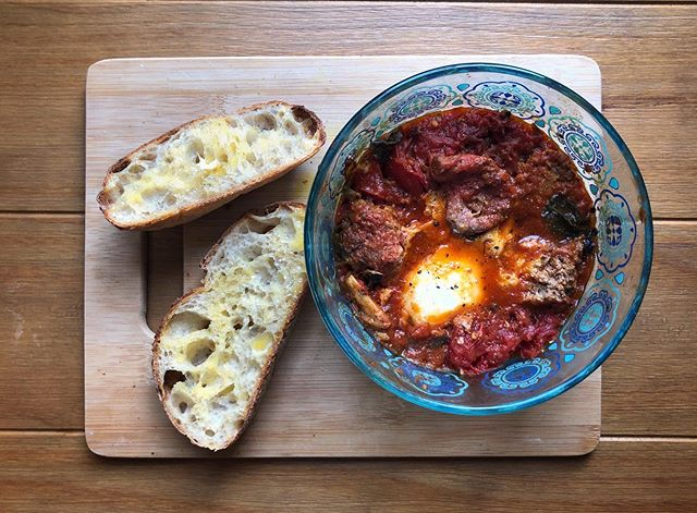 @katherinesacks had me over the other day to make @epicurious Sunday Sauce for @melanie__button. I took some home and immediately saw an opportunity for innovation: crack an egg into it, stick it in the microwave, and it becomes shakshuka! Also present and always appreciated: @shewolfbakery sourdough batard.