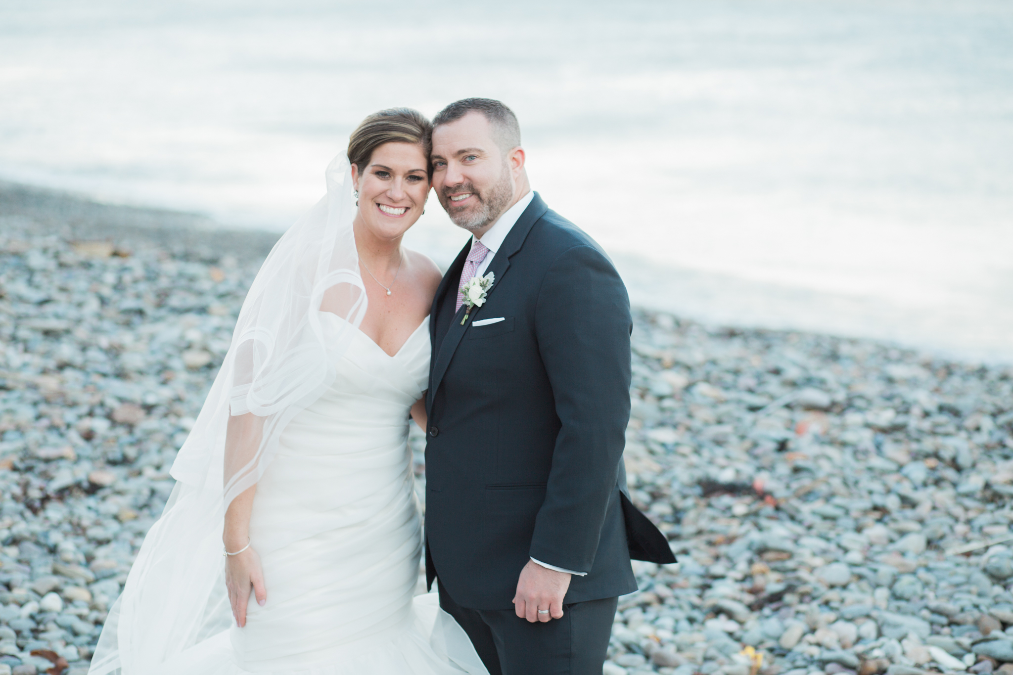Click over to see more from this rocky beach, fall wedding.