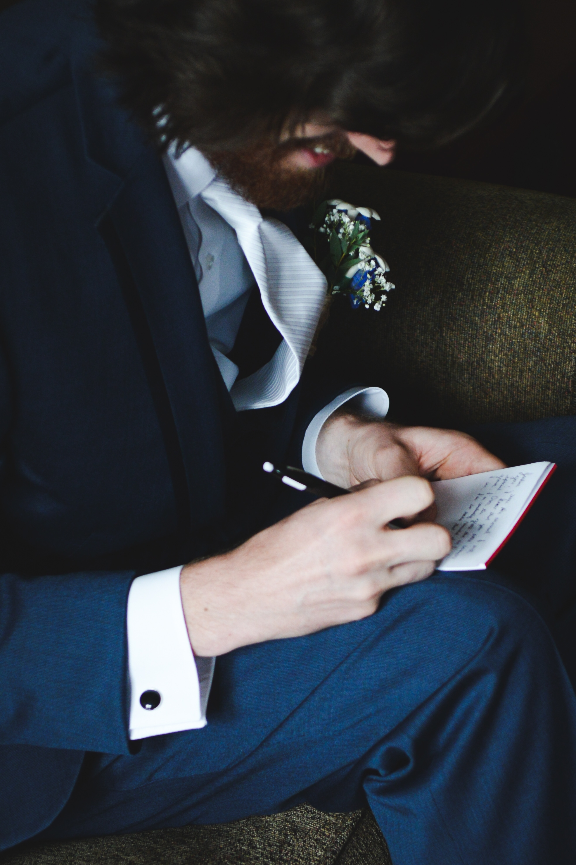 groom writing his vows