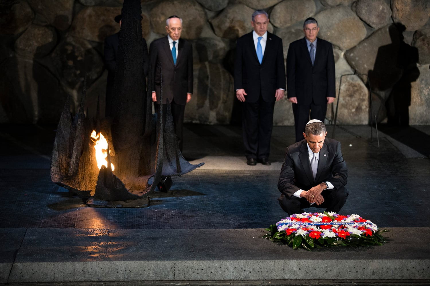 President Barack Obama pauses after adjusting a wreath placed in the Hall of Remembrance during his visit to the Yad Vashem Holocaust Museum in Jerusalem, March 22, 2013. Standing behind the President, from left, are: Rabbi Yisrael Meir Lau; Israeli President Shimon Peres; Israeli Prime Minster Benjamin Netanyahu; and Avner Shalev, Chairman of the Yad Vashem Directorate. (Official White House Photo by Chuck Kennedy).