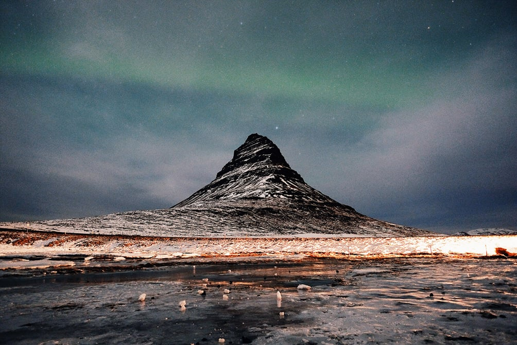 Northern lights over Kirkjufell  We were out for 2-3 hours shooting the northern lights over Kirkjufell. This was the early signs of the lights which exploded later on right around the mountain.