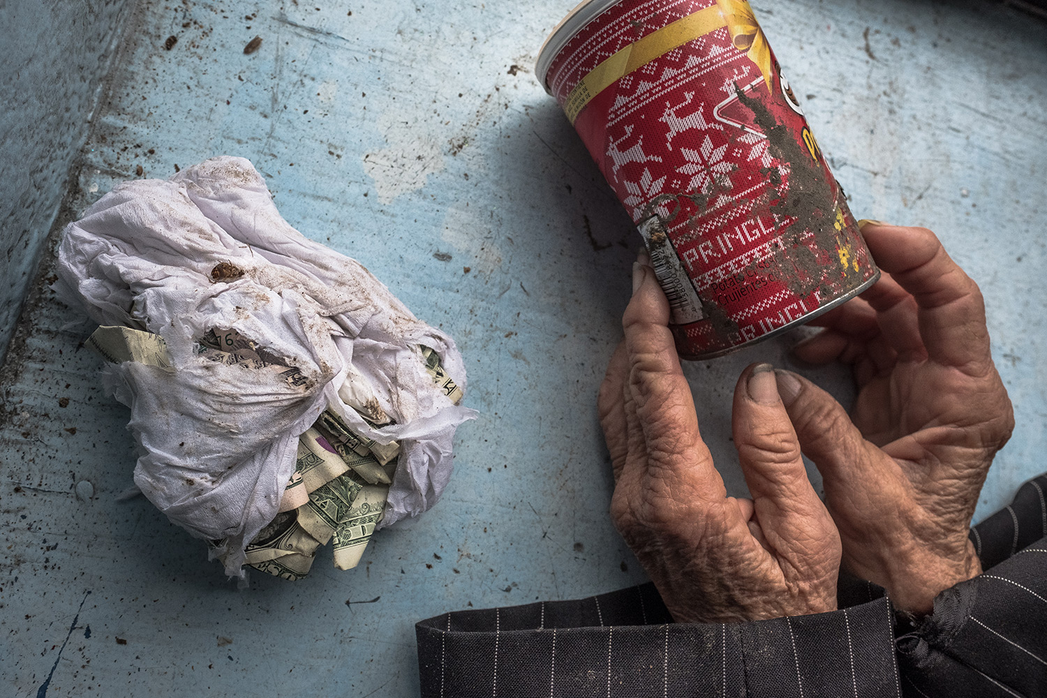 Lee Ann collects and keeps garbage — seen with Kleenex and money, topped by a dead cockroach, three defining elements in her life.