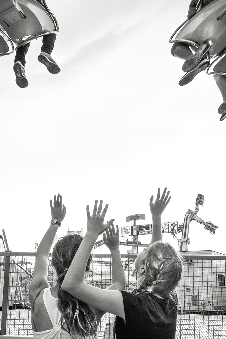 Greetings —Two girls wave to riders at the San Diego County Fair in Del Mar, CA.