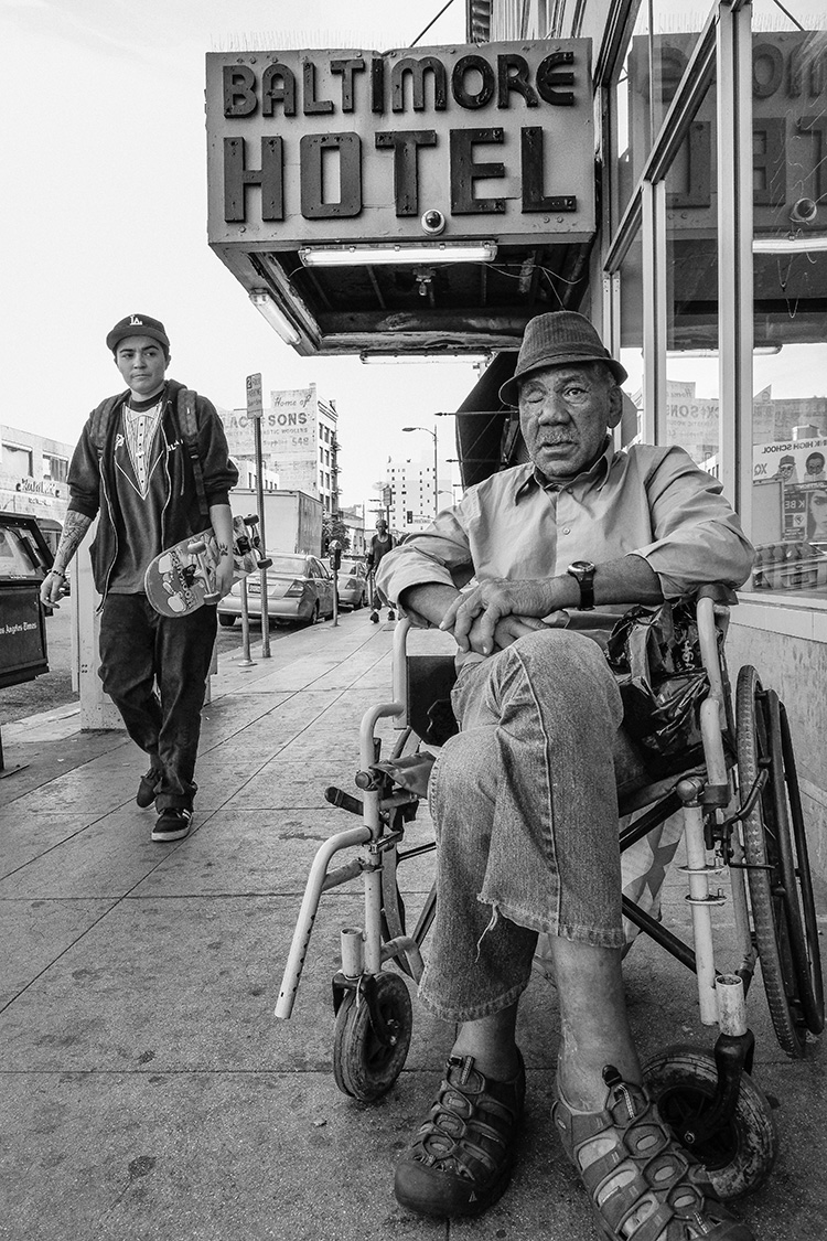 Red in front of The Baltimore on 5th And Los Angeles St. A Vietnam veteran who has lived through several incarcerations.