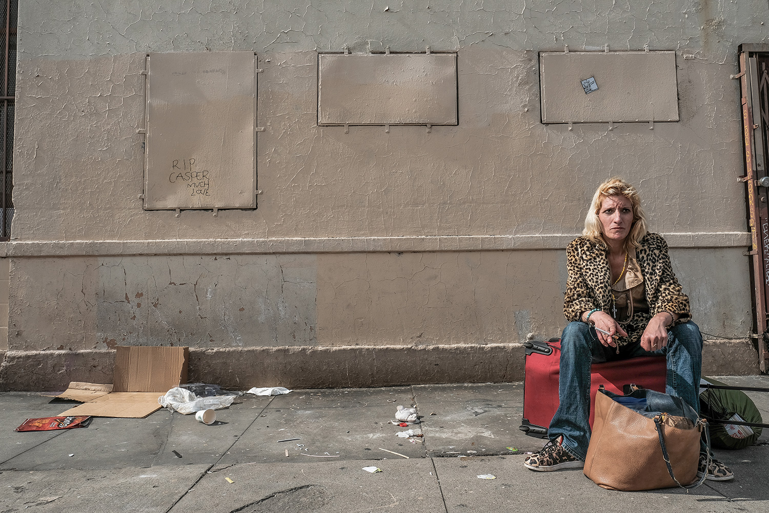 Floating — C. sits at 4th and Towne Ave after using heroin, lost in thought.