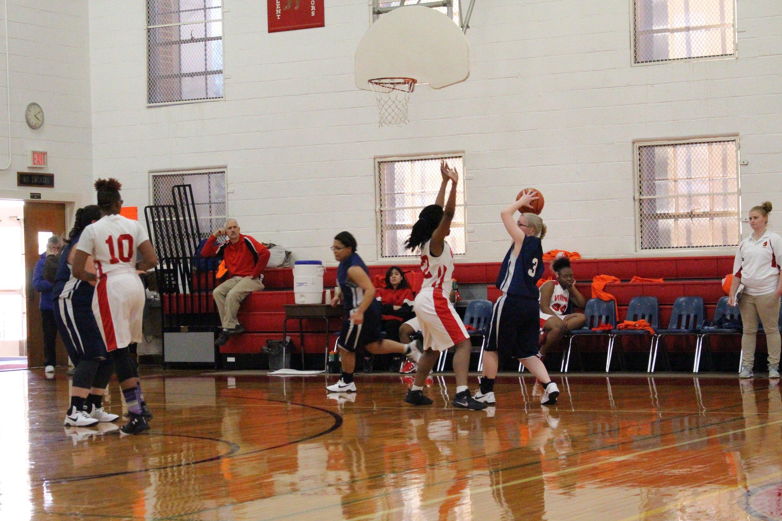 girls basketball in play.jpg