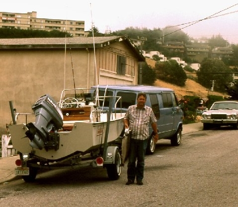 Laura's Dad Bob with a salmon, his Boston Whaler, and the family van