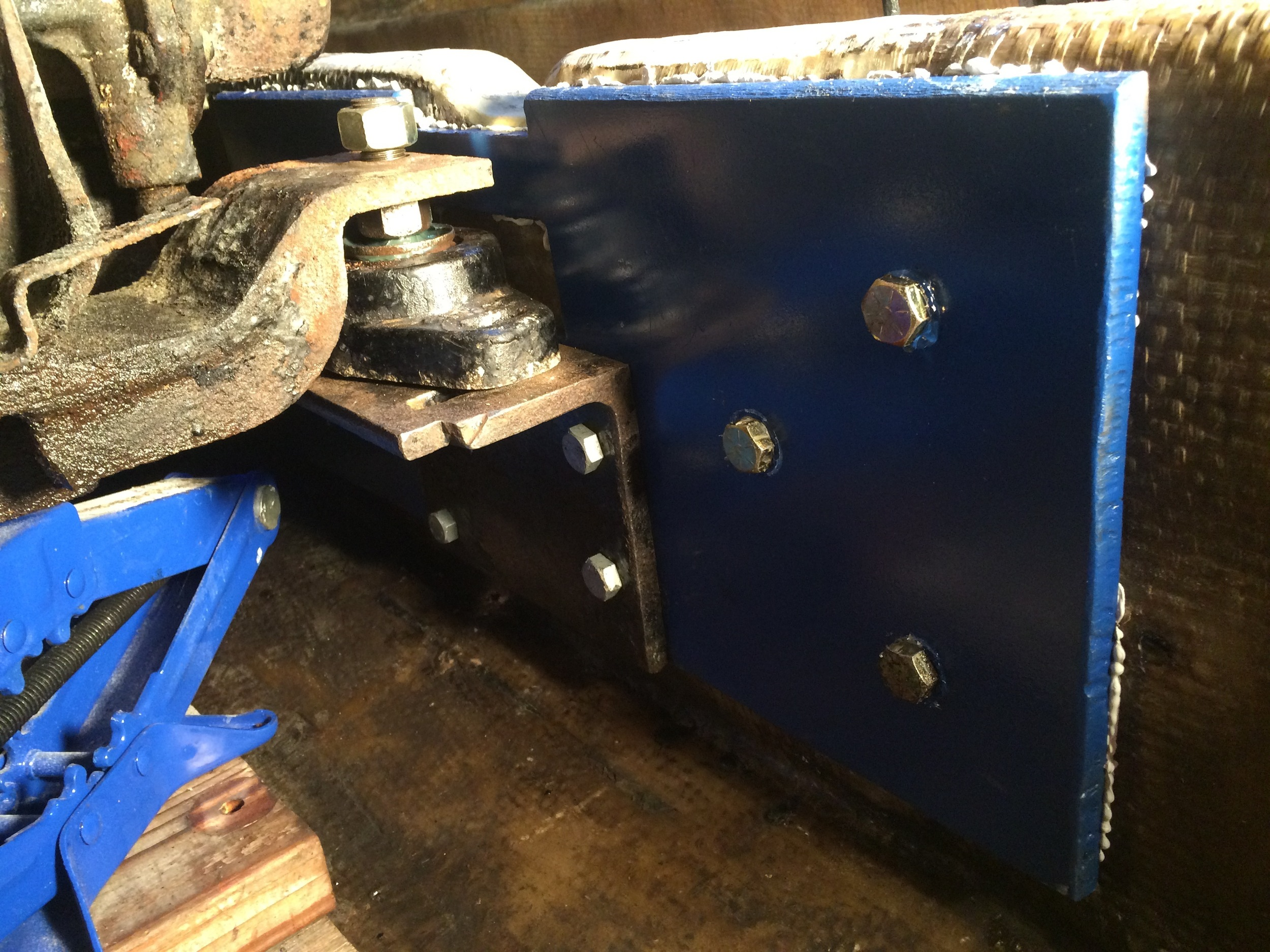 engine mount and steel plates reattached to fiberglass stringer