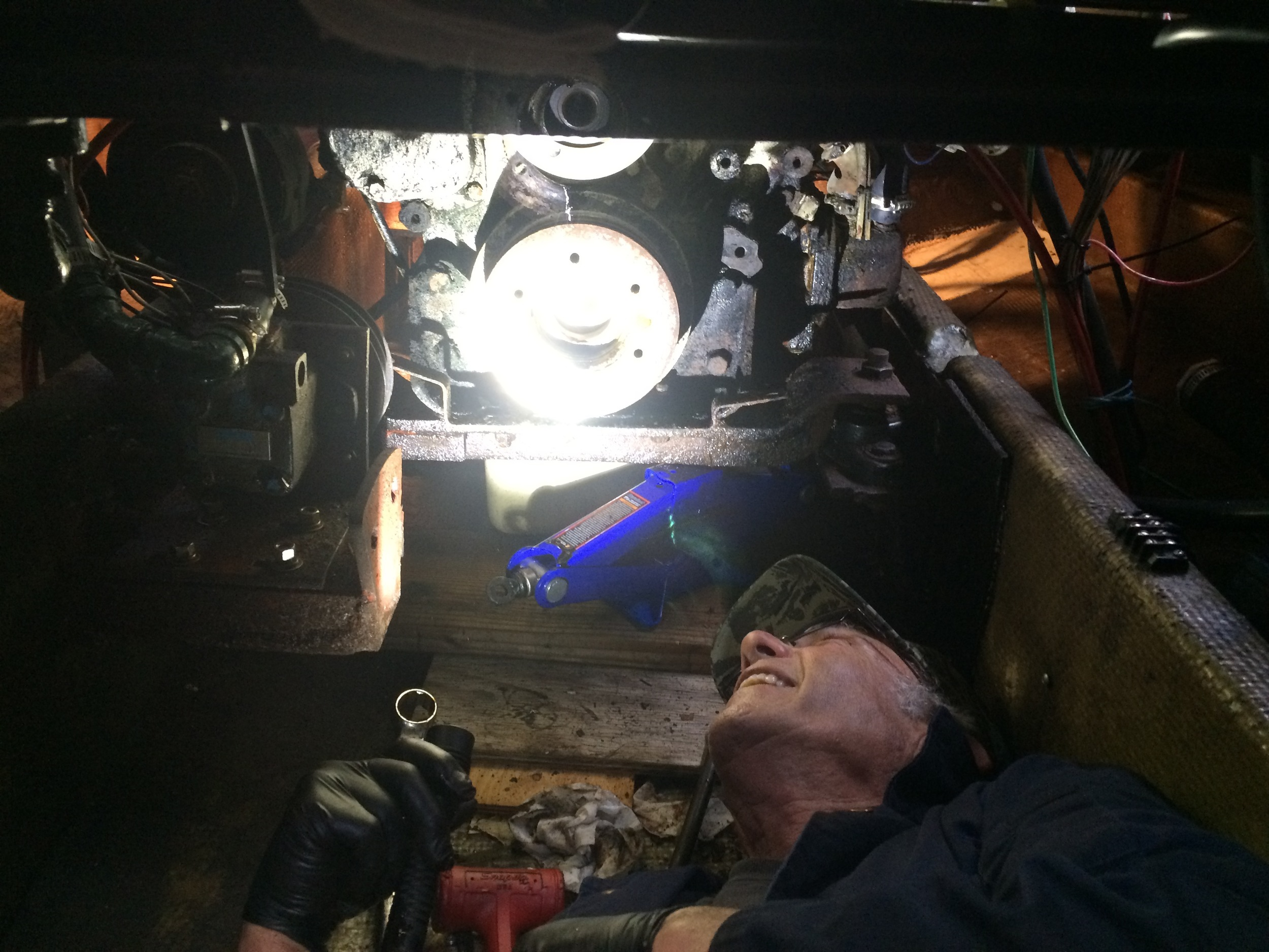 Don assessing the front crankshaft seal removal in our (thankfully) dry bilge