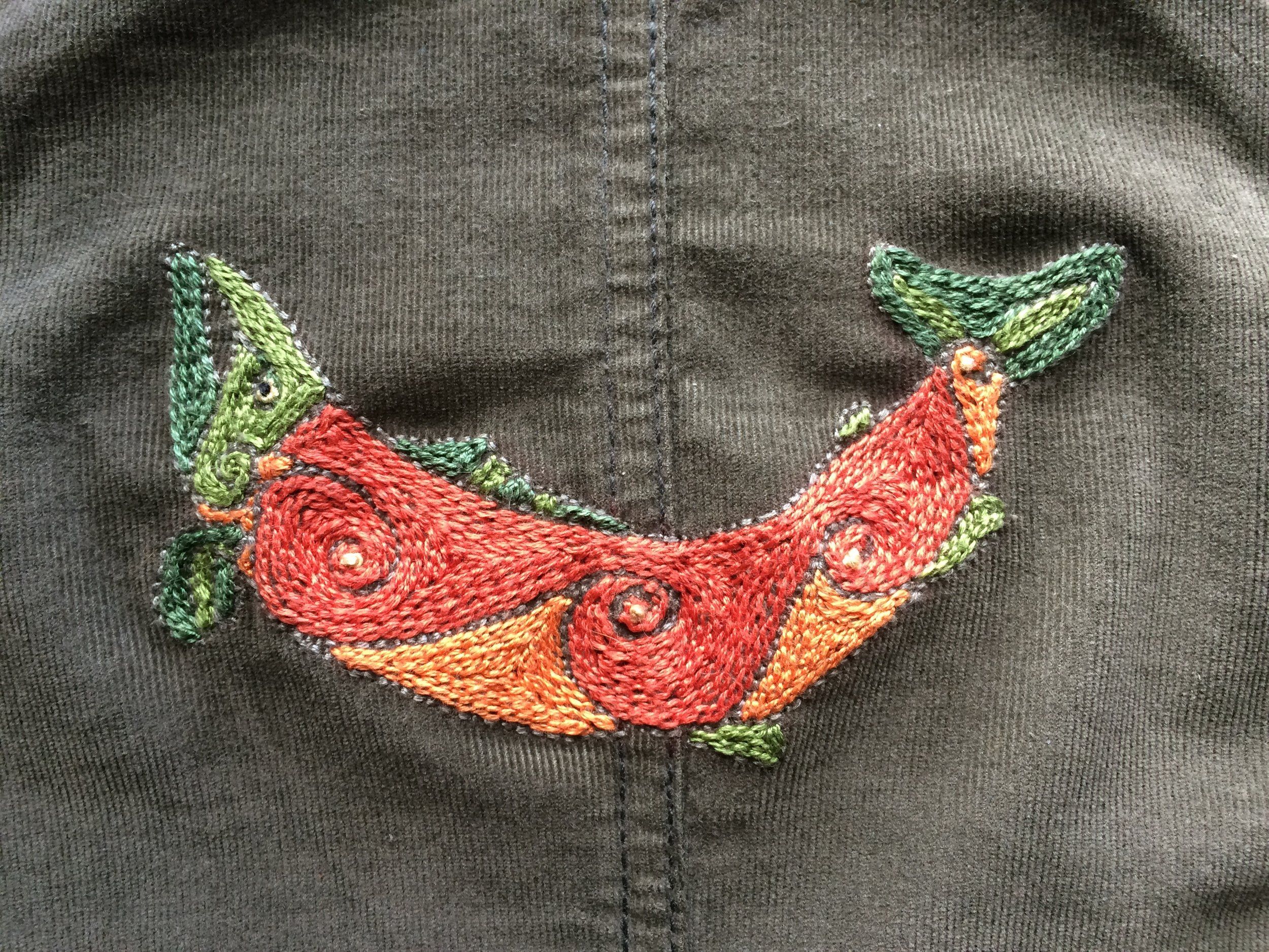 finished embroidery based on Celtic salmon painting