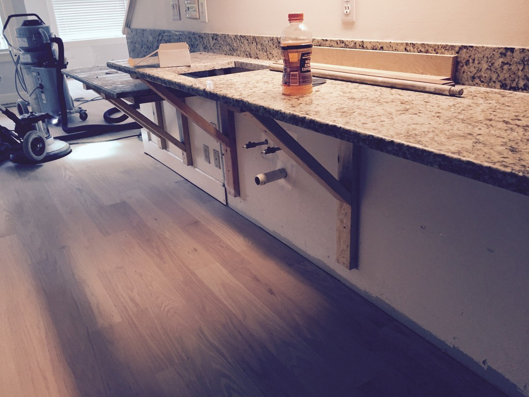 Insurance calims water damage new cabinets saved counters.jpg