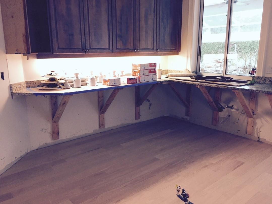 Saved countertops floors insurance claim water damage.jpg