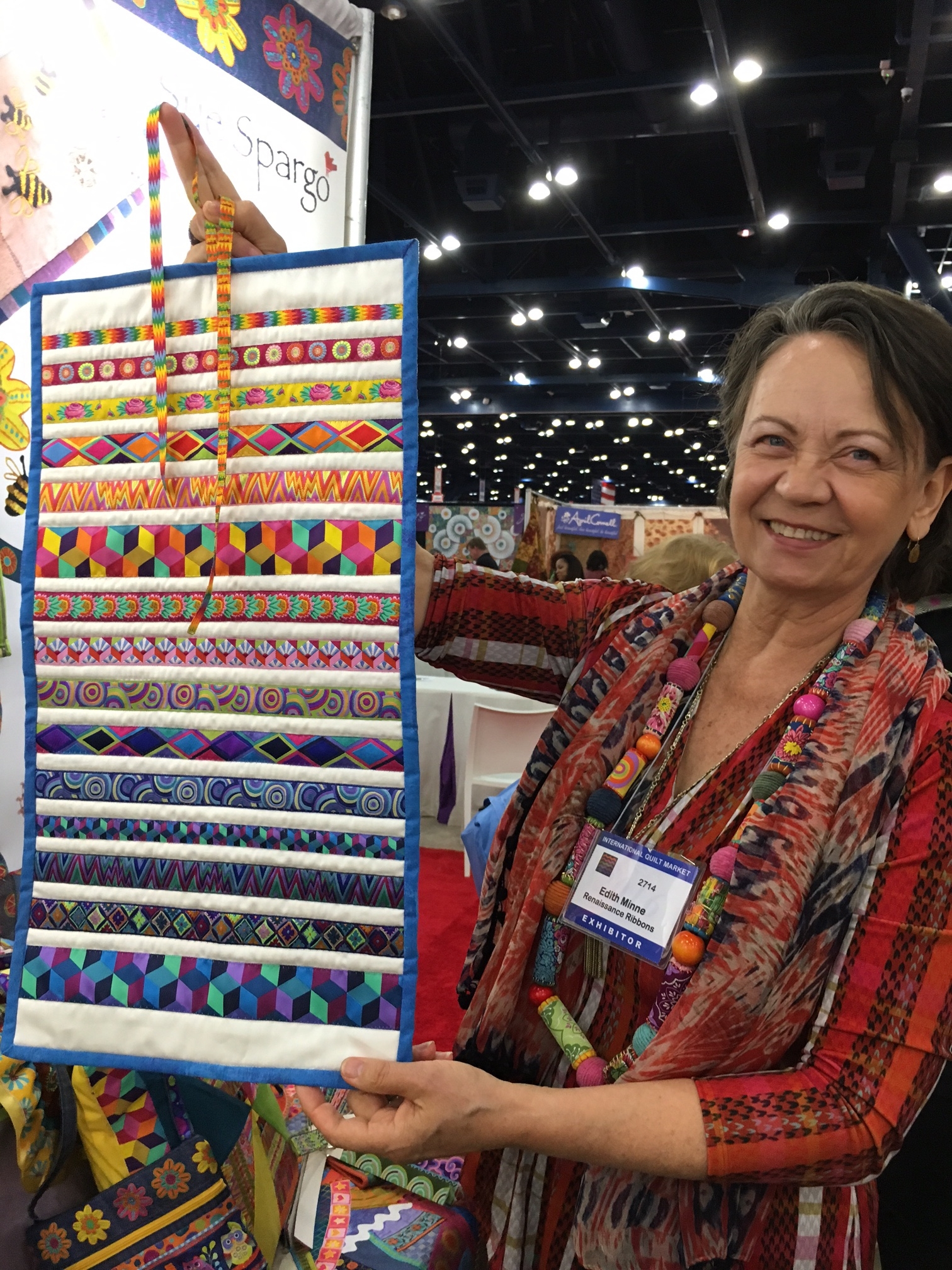 Edith Minne of Renaissance Ribbons displays her Kaffe Fassett Collective ribbons.