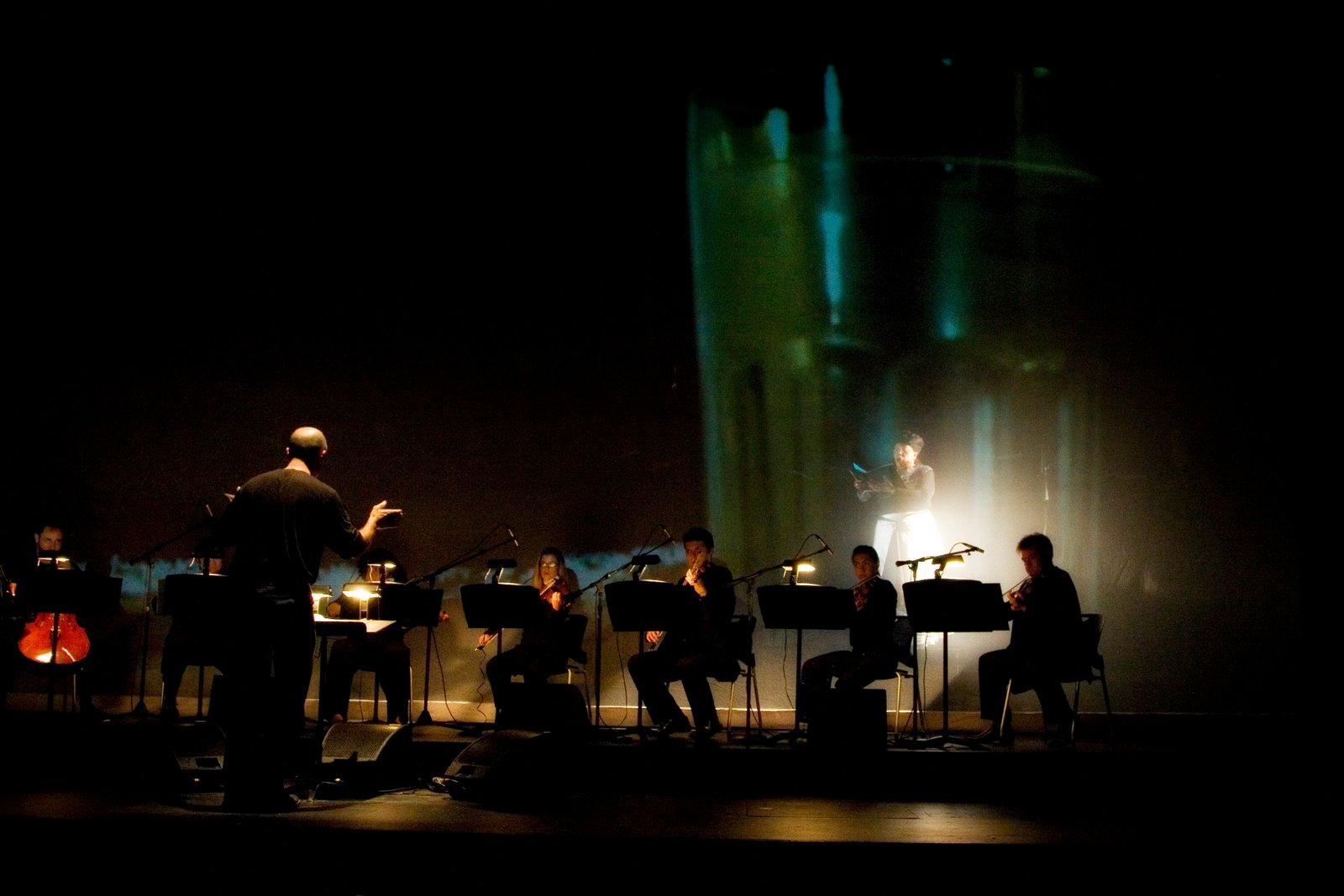 Soloist Up-Stage of Scrim with Projections