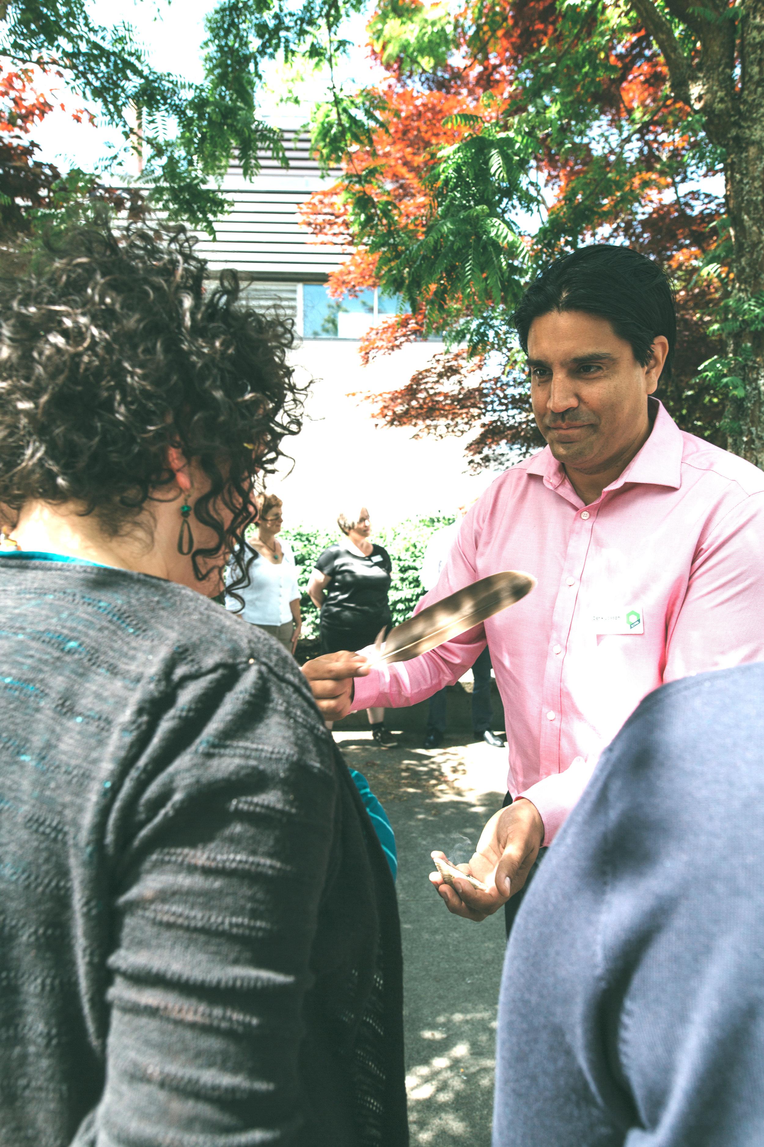 Diversity Circles Co-Creator Zaa Joseph participates in a group smudging ceremony.