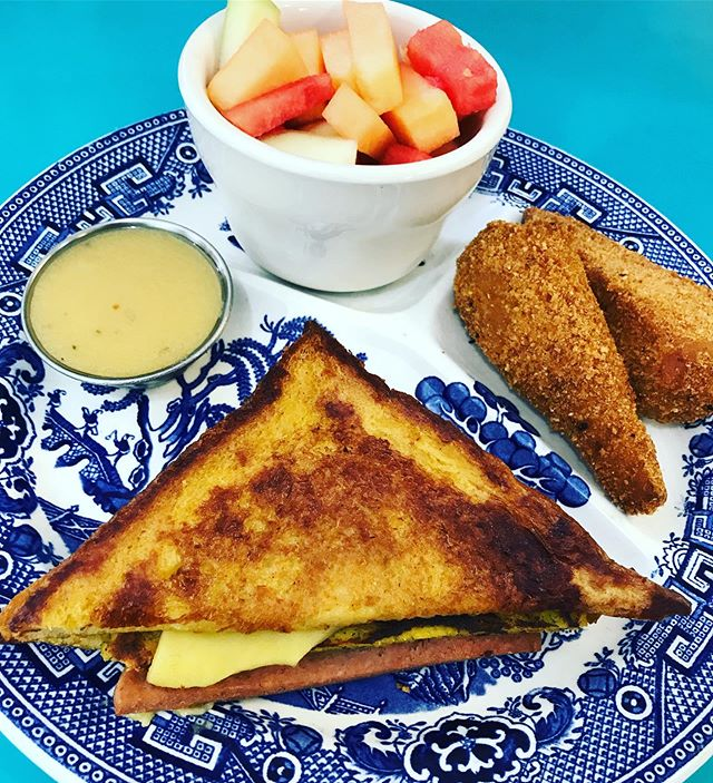 WEEKEND SPECIAL!! . . Starting at 9 AM! . . Madame sampler blue plate: Half of a croque madame (ham, tofu egg, & chao on thick cut french toast) and 2 breaded and fried chikn drumstix served with agave-dijon and a cup of melon! 🍗🍉