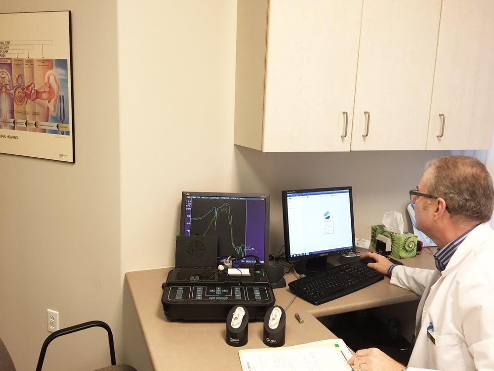 Larry Preparing a Conductive Hearing Loss Report.JPG