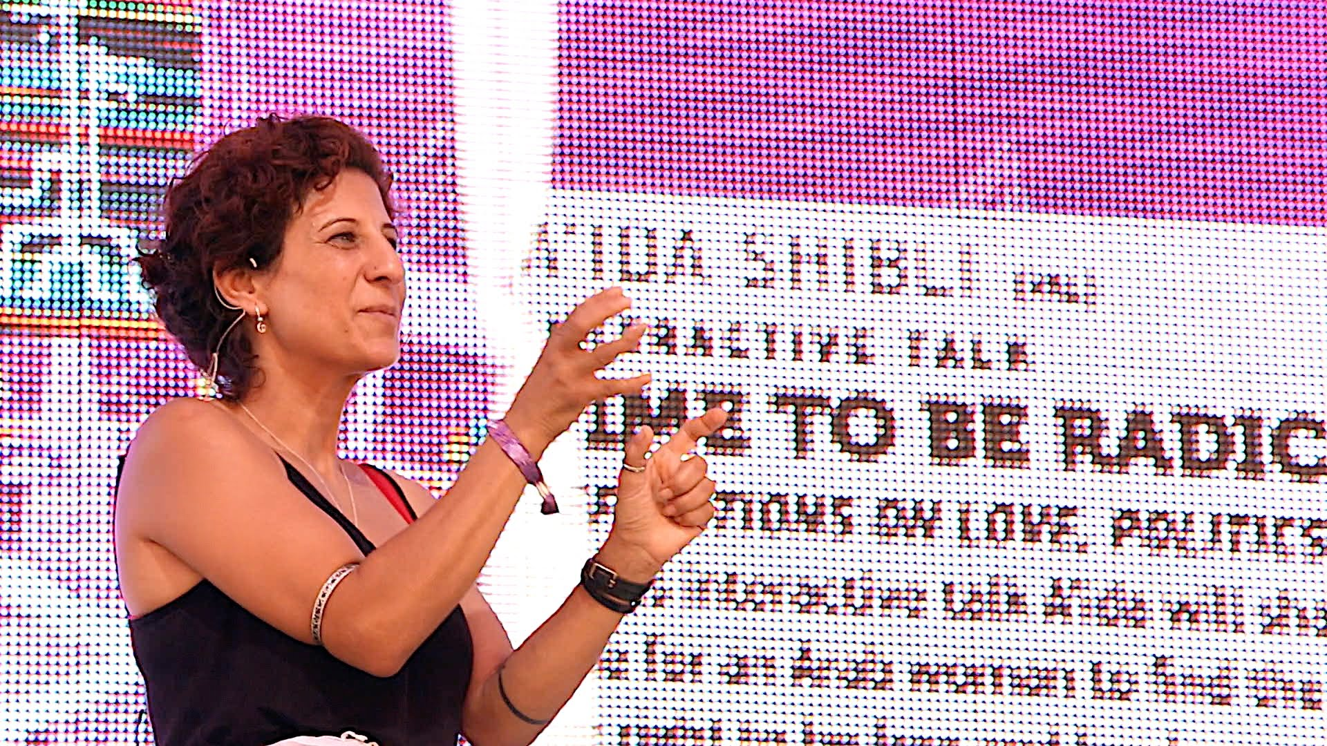 Aida speaking at Boom Festival 2014 in Portugal about political activism