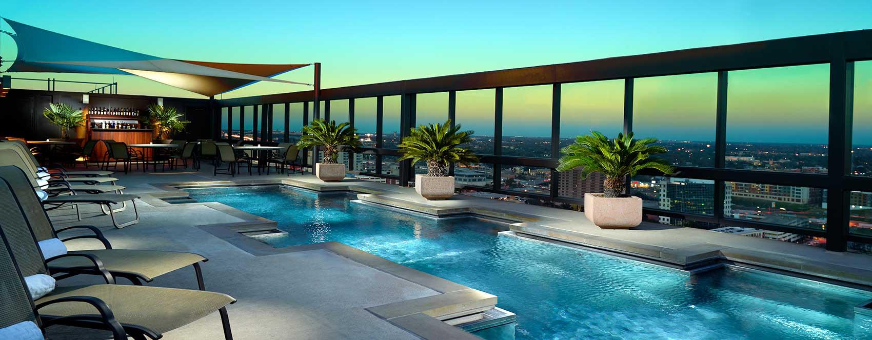 ausctr-omni-austin-hotel-downtown-evening-pool-1700x663.jpg