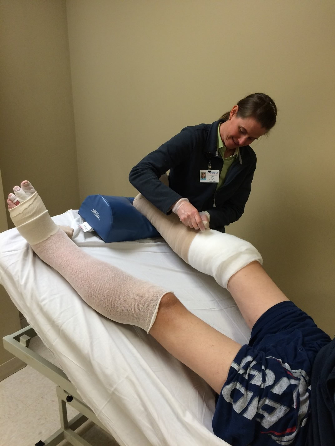 Image of Lymphedema Therapist Wrapping Legs