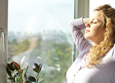lady enjoying cold air at home