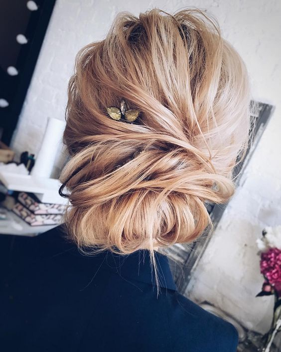 Keeping up with the updo's, I'm obsessed with this one! I'm all about loose, romantic hairstyles with a touch of messiness and this one fits the bill perfectly!