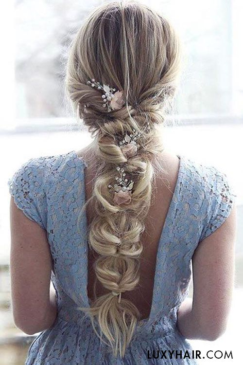I am a huge fan of super loose braids. This one is a mock braid, but absolutely beautiful! If it's too everyday for you, consider having your bridesmaids have loose braids!