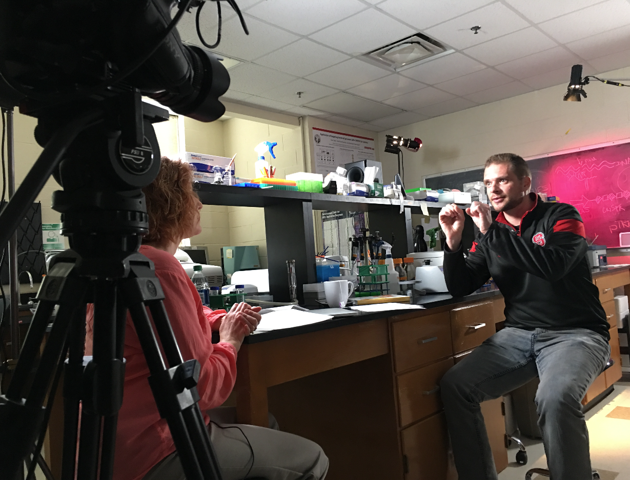 Dr. Barrangou explains a complicated idea during Lynne's interview at the lab.