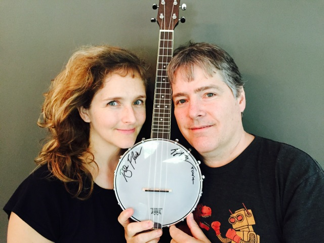 Abigail and Béla show off a donated banjo uke.