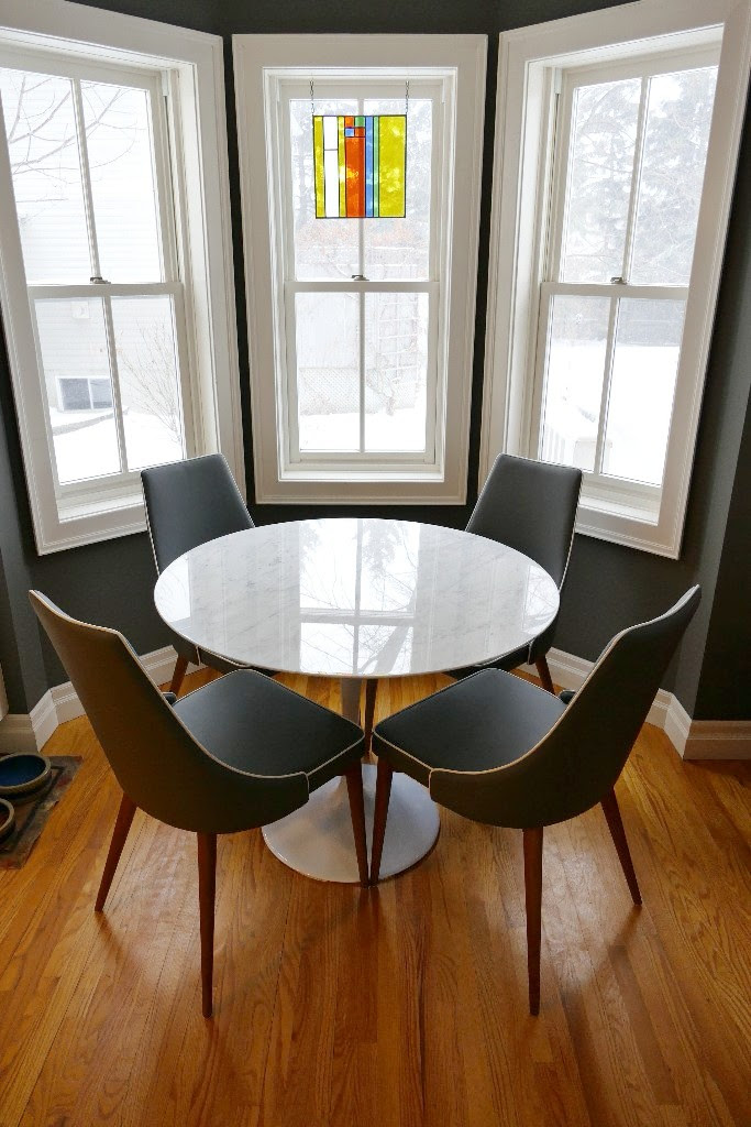 "Marble dining table and ""Moor"" dining chairs in grey."