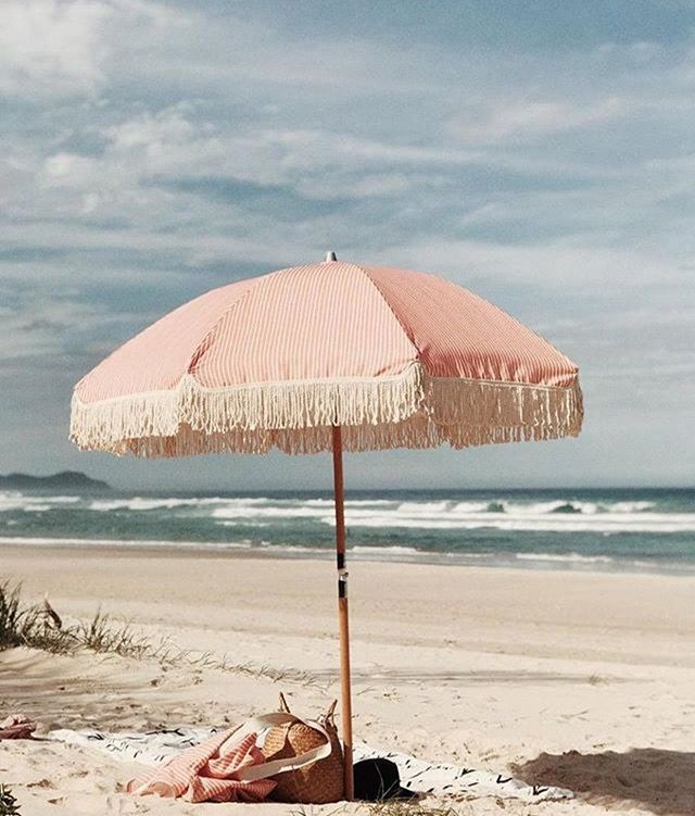 Summer's so close we can practically smell the sea breeze 🏖 . . . #beach #umbrella #sea #summer #sand #pink #holiday