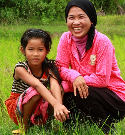 CAPTION: Sun Ley and her daughter in the rice fields surrounding the village of Tramung Chrum in Kampong Chhnang Province, rural Cambodia.