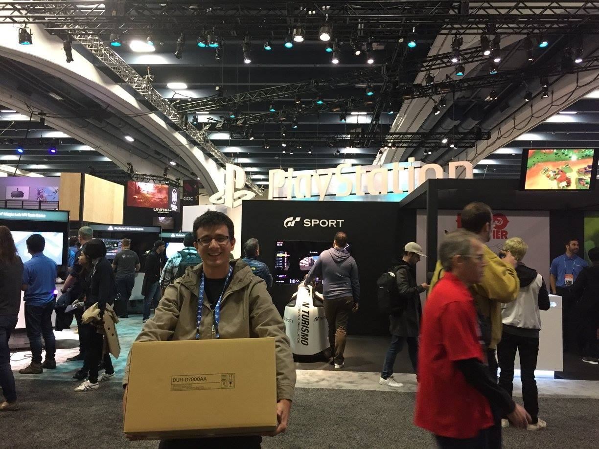 Mauriccio carrying the box with the Play Station 4 dev kit in it.