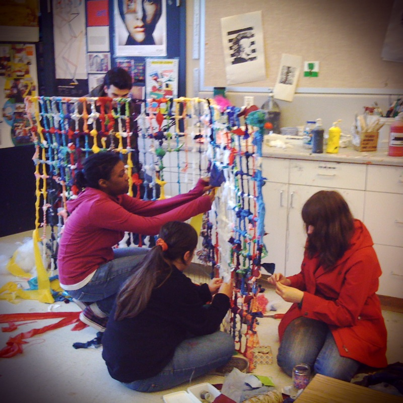 Making a sculpture from a recycled wire form and scraps of fabric.