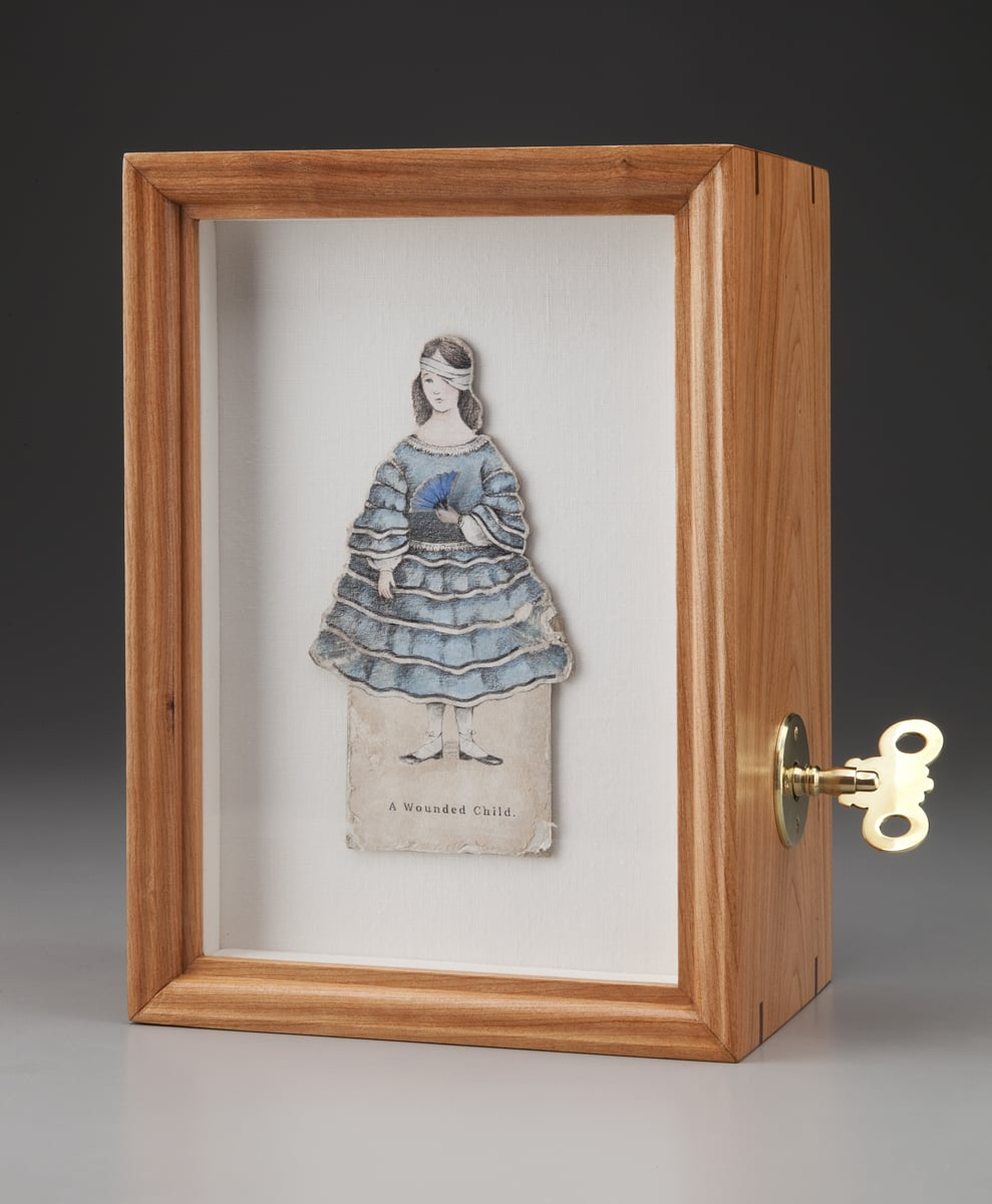 """A Wounded Child . Automata. 2013. Paper, Colored pencil, Acrylic, Linen, Cherry, Mahogany, Brass, Self-fabricated mechanism with spring motor, Hardware. 10.25"""" h x 7.25"""" w x 5"""" d."""