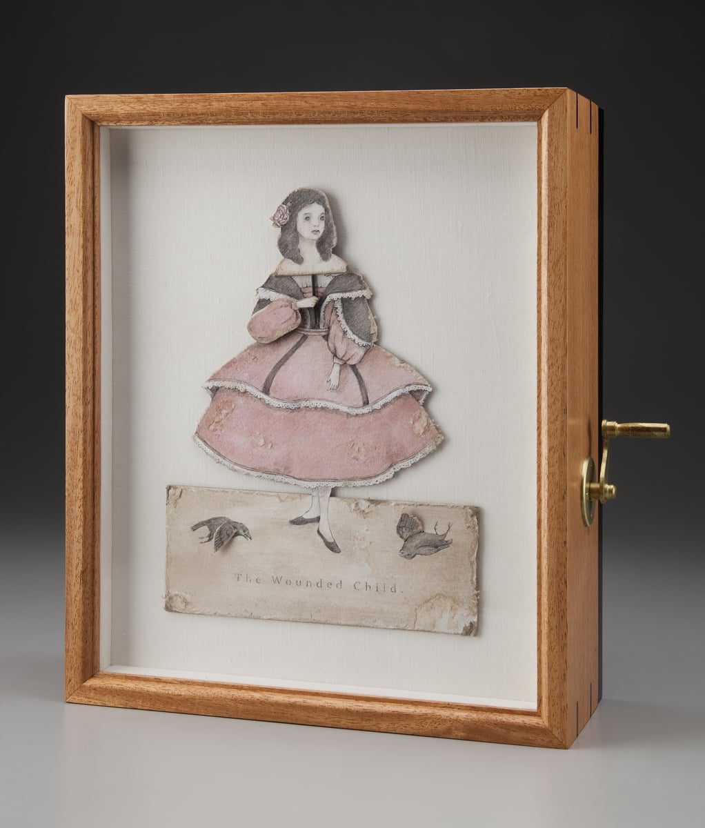 """The Wounded Child . Automata. 2013. Paper, Colored pencil, Acrylic, Linen, Cherry, Ebony, Brass, Self-fabricated mechanisms, Hardware. 13 ½"""" h x 11"""" w x 4 ¾ d."""