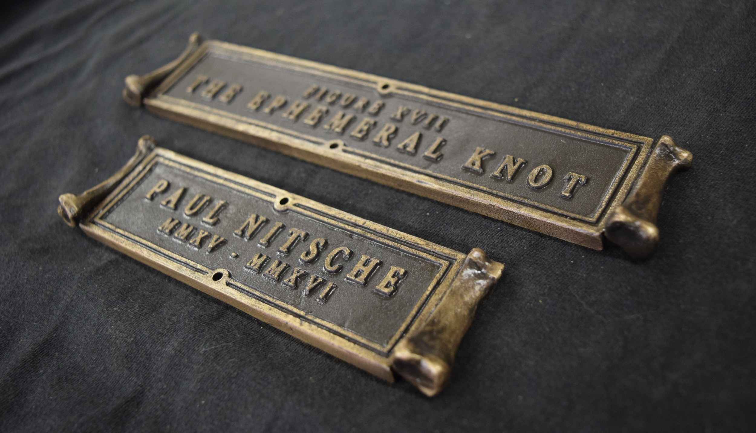 The bronze title and name plates for The Ephemeral Knot.