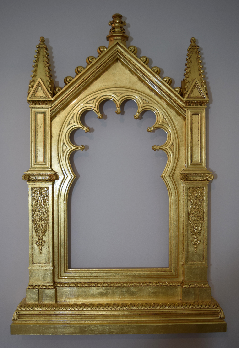 The finished gilded frame. The gold leaf has been toned down with a thin layer of oil paint, and clear coat applied.